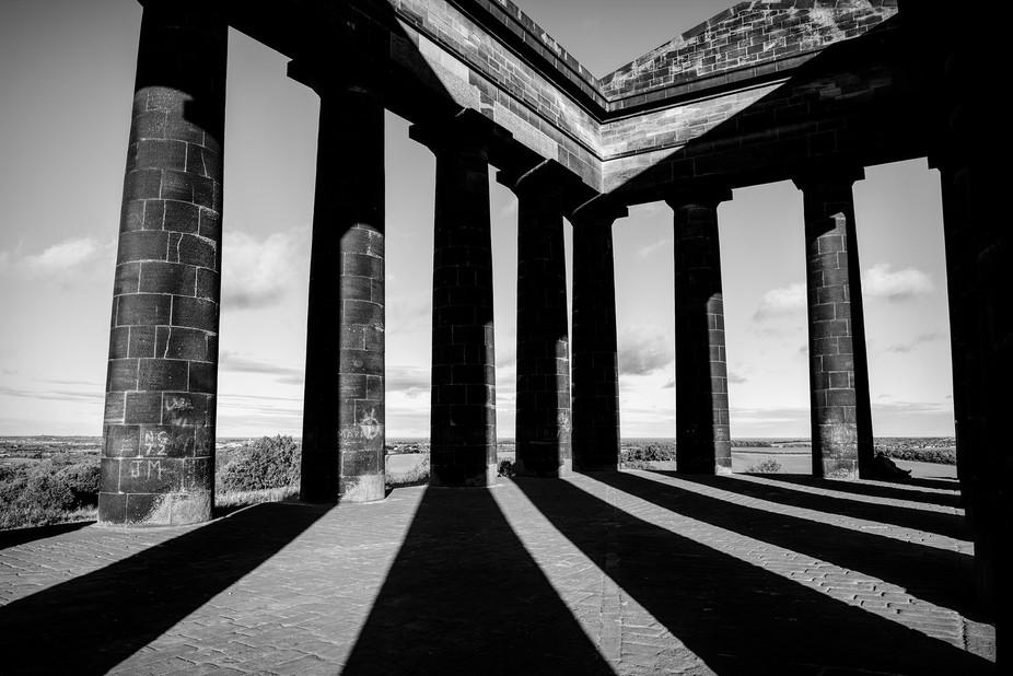 Penshaw Monument in NE England and  shadows form it pillars onto its pillars