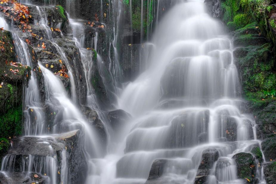 Eastatoel Falls is a beautiful 60 foot waterfall near Rosman North Carolina.Seen here in autumn. ...