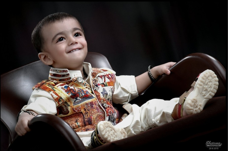 studio shoot boy happiness chair