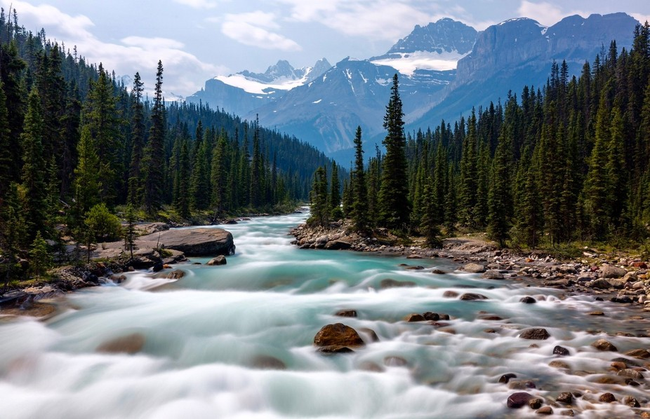 Image captured during a trip to the Rockies earlier this year. Wonderful glacier river rushing do...