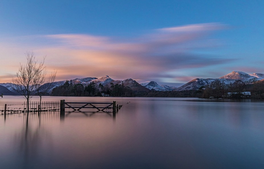 Long exposure shot after sun rises over snowy mointains in the Lake district, england