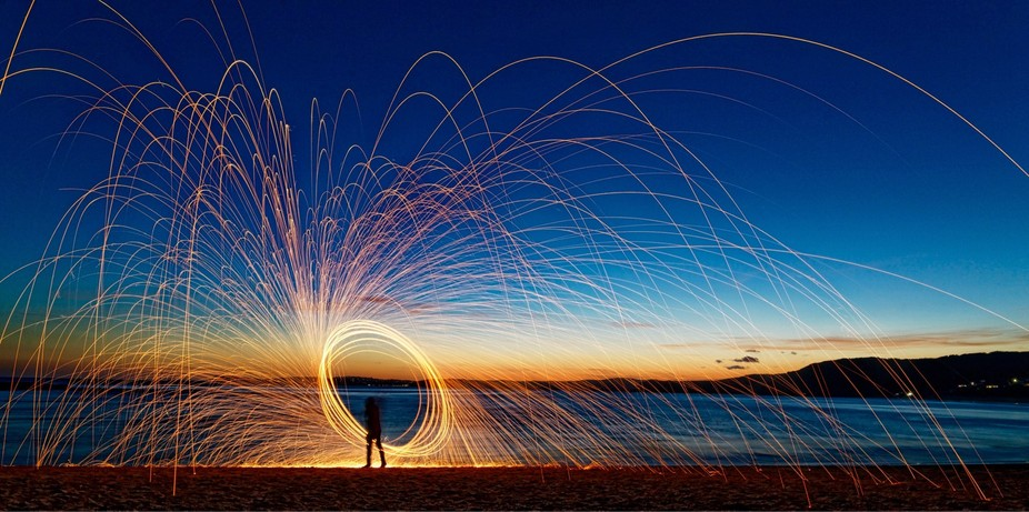 Throwing sparks at sunset