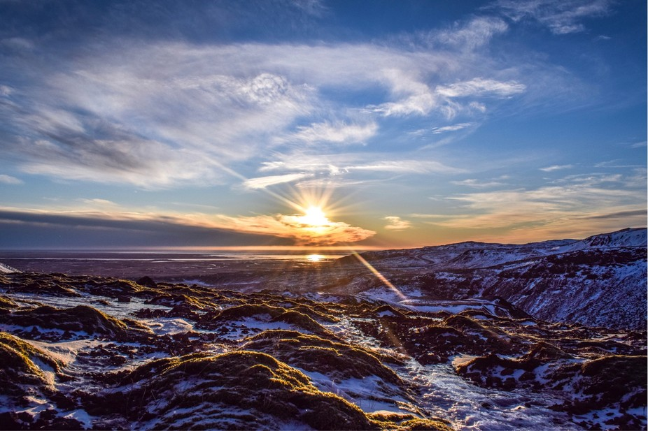 The sun towers over the valley in Iceland