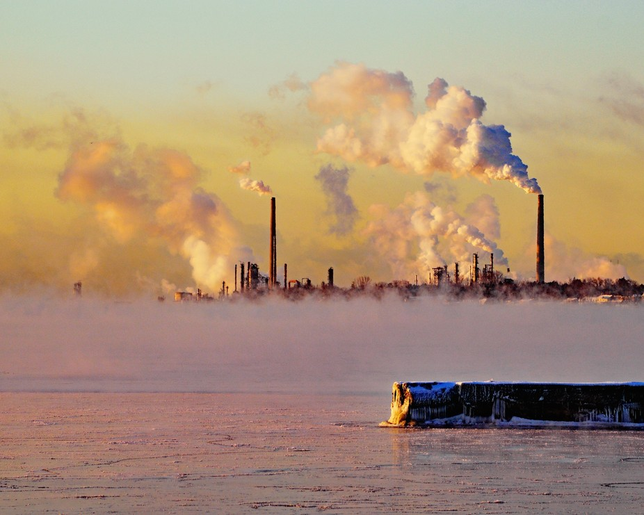 Clouds of steam from an industrial complex at sunrise on a bitterly cold January morning