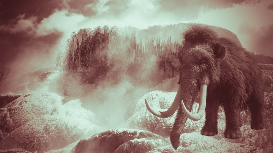 A giant Mammoth in front of a freezing forest.