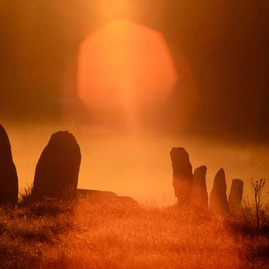 Sunrise over megaliths.  Brittany, France.