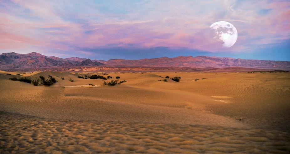 Super moon rise over Mesquite Dunes in Death Valley