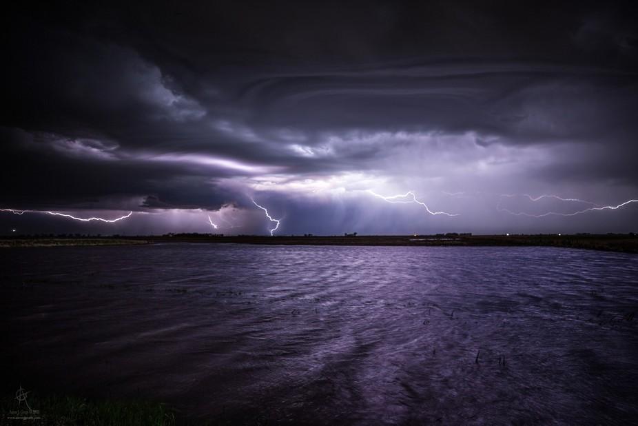 """ripples"" www.aaronjgroen.com  Last night's lightning over a flooded f..."