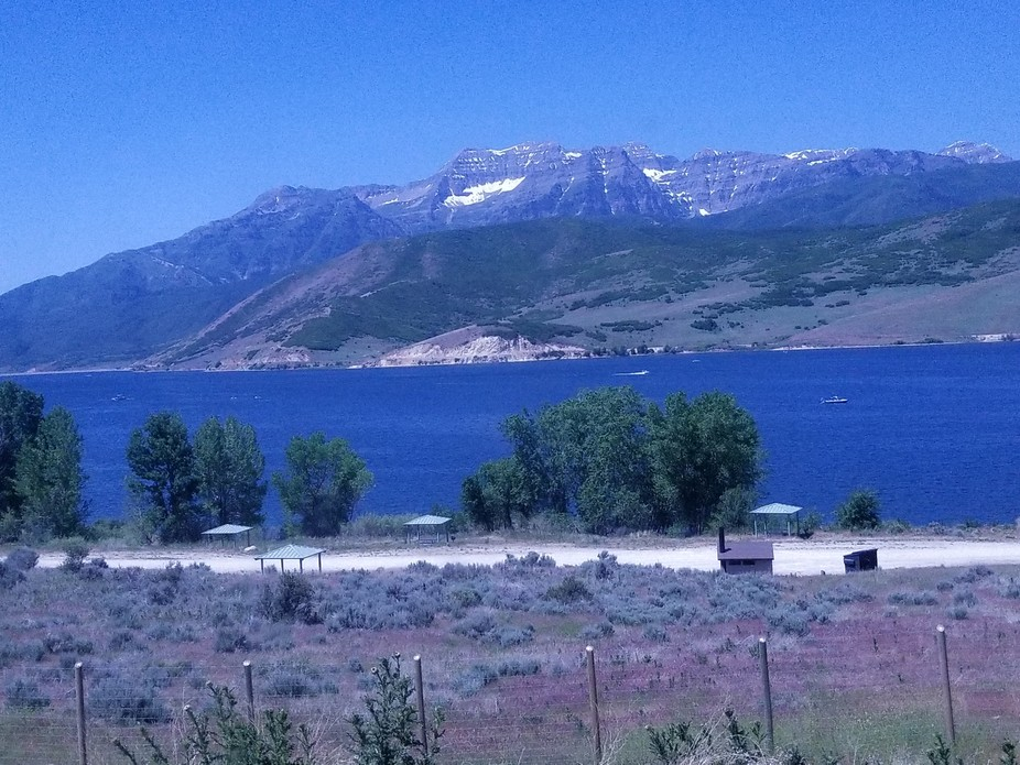 Driving through Utah's scenic Provo Canyon. A beautiful summer morning...and still have snow capped mountains!