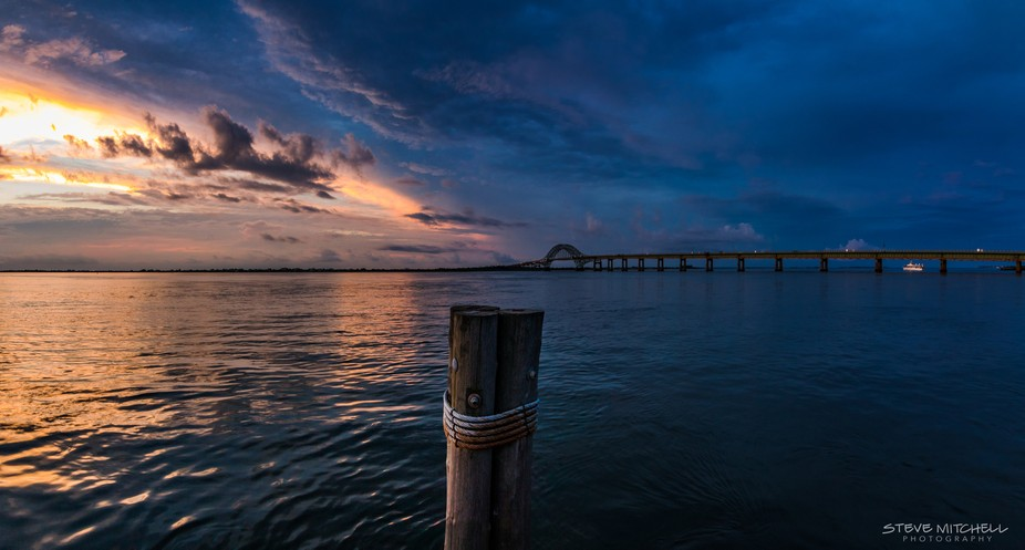 The moody blues during sunset over Fire Island Inlet and the Robert Moses Bridge, Long Island, NY.