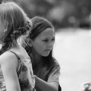 Siblings playing in the park.
