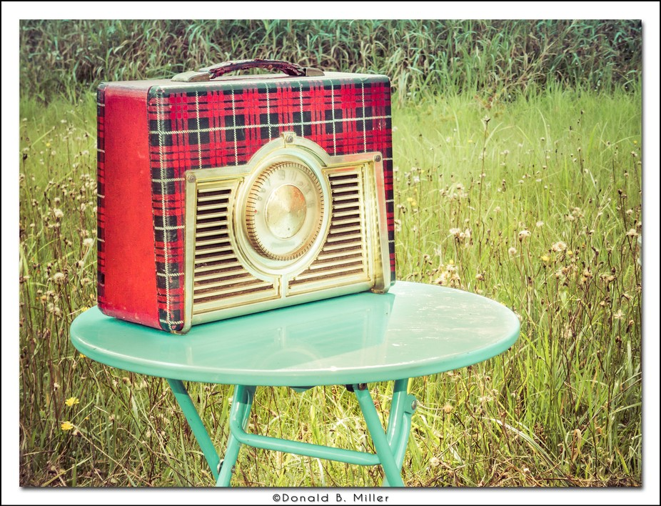 An antique radio by an antique truck at our local country fair today.