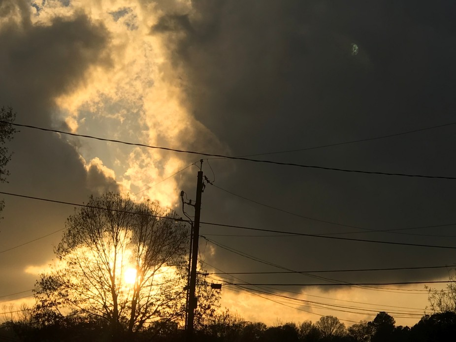 A beautiful sunset, with  a storm on its back. :-)